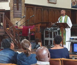 Prince giving a presentation at a Vocations day