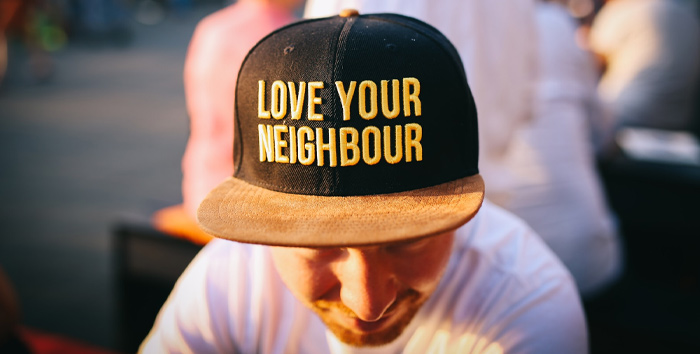 Love your Neighbour - man with a cap